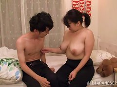Japanese Mom Sucks A Prick And Enjoys Banging In The Missionary Pose