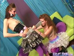 Foxy Lesbian Damsel In Fishnet Pantyhose Being Pounded With A Toy On A Couch