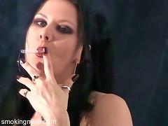Dark Makeup And Lipstick On Smoking Goth Girl
