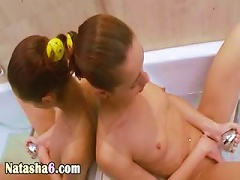 Brunet Playing With Shower In Bathroom