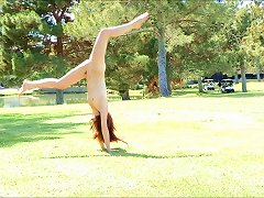Stripping Babe On The Lawn In Reality Movie Shows Acrobatic Moves
