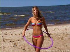 Bikini Teen Strips On The Beach And Hula Hoops In The Nude