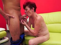 Young Man Is Plesing A Redhead Granny On The Couch