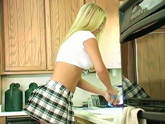 A Beautiful Blonde In A Sexy School Uniform Poses In A Kitchen
