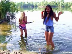 Wet Chicks Splashing In The Lake And Eating Pussy On The Shore