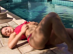 Tattooed Teen Is Lying At The Poolside