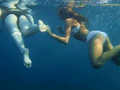 Two Sensual Babes Enjoy Diving In The Ocean While Being Naked