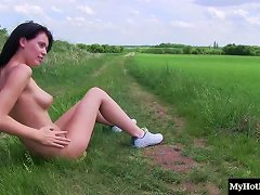 Teen Stripping Outdoors And Slowly Rubbing Her Shaved Pussy
