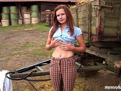 Farmer Babe Hides Behind A Trailer And Fingers Her Slit