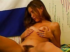 Pretty Teen Rubs Her Hairy Pussy And Gets Wet