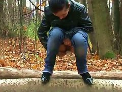 Slim Brunette Teen In Jeans And Jacket Pisses In The Autumn Forest