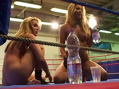 Two Tired Naked Beauties Relax After Fighting Hard Inside Boxing Ring