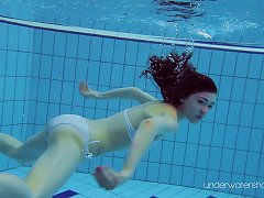 Lovely Redhead Euro Babe Has Some Fun In The Pool While Being Naked