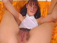 Amateur Pigtailed Teen Shows Off Her Hairy Pussy