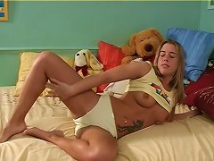 Tattooed And Cute Teen Goes Wild Masturbating Warmly Using A Toy In A Solo Clip