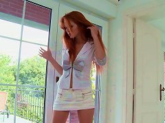 Sizzling-hot Redhead Strips Out Of Her Clothes And Fingers Her Hungry Twat