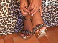 Sweet Girl In An Angel Costume Rubs Her Beautiful Feet