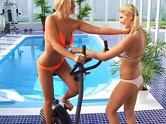 A Pair Of Blonde Hotties Fuck Next To A Pool At A Hotel Gym